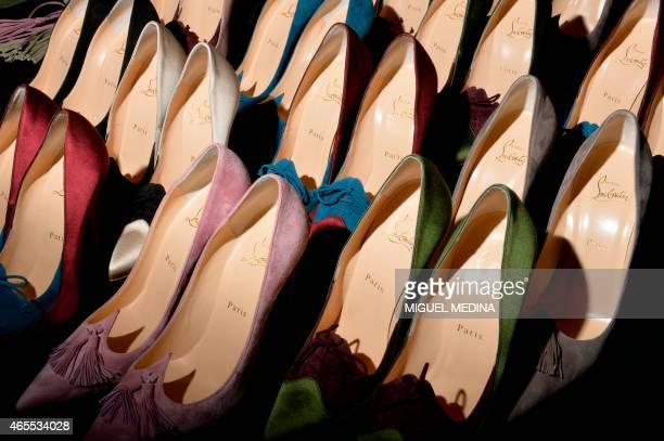 A picture taken on March 7 2015 shows Louboutin shoes backstage before Olympia Le Tan 20152016 fall/winter readytowear collection fashion show on...