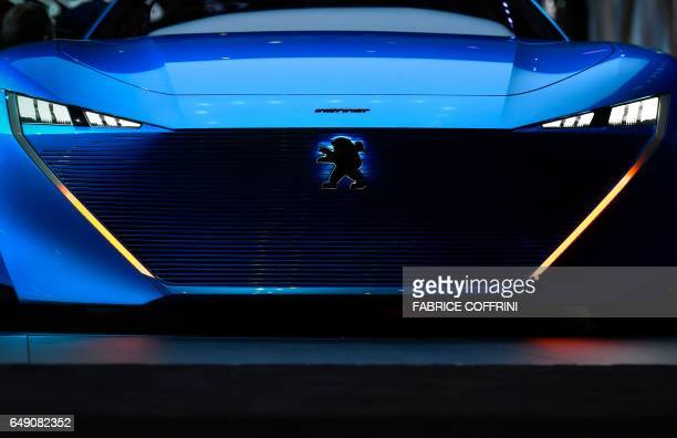 A picture taken on March 7 2017 shows the Peugeot Instinct concept car during the first press day of the Geneva International Motor Show in Geneva...
