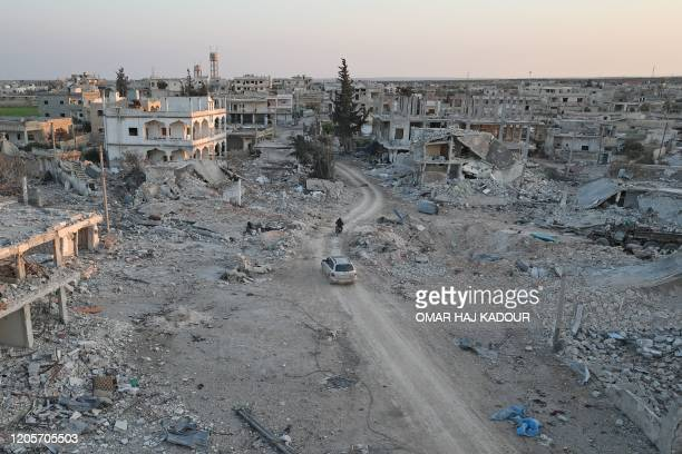 Picture taken on March 7, 2020 shows destruction in the village of al-Nayrab, about 14 kilometres southeast of the city of Idlib in northwestern...