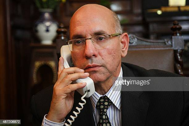 A picture taken on March 8 2015 shows Egypt's agriculture minister Salah Halal speaking on the phone at his office in Cairo Halal was arrested in...
