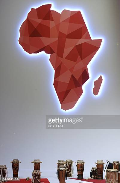 A picture taken on March 8 2016 shows djembes under an Africa's map in Dakar during the opening of the 'Next Einstein Forum' Africa's top scientists...