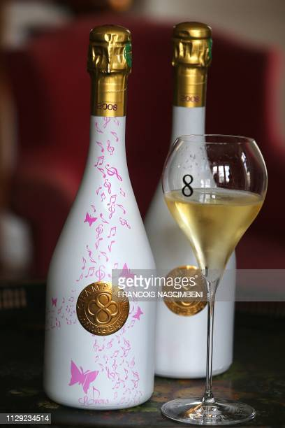 A picture taken on March 8 2019 in VilleDommange near Reims northeastern France shows two bottles of Infinite Eight brand's champagne bearing rose...