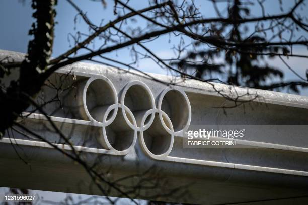 Picture taken on March 8, 2021 in Lausanne shows the Olympic rings next to the headquarters of the International Olympic Committee ahead of a session...