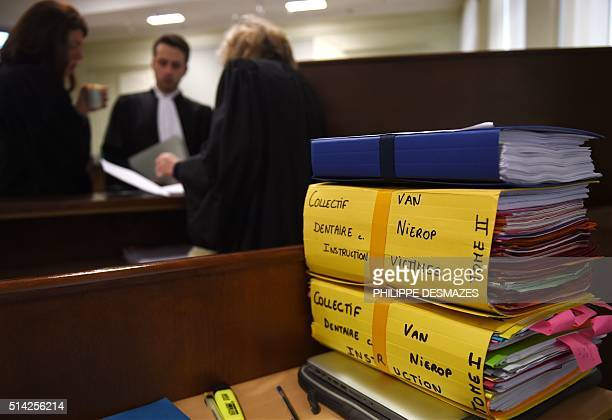 A picture taken on March 8 shows folders of the trial of Dutch Jacobus Marinus Van Nierop dubbed as The dentist of the horror at the Nevers...