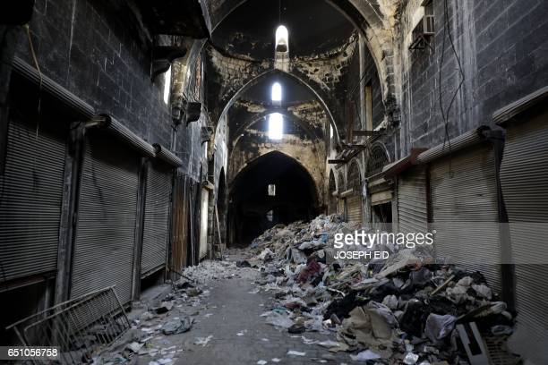 A picture taken on March 9 2017 in the northern Syrian city of Aleppo which was recaptured by government forces in December 2016 shows the damage...