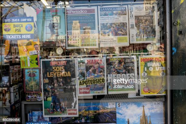 A picture taken on March 9 2017 shows frontpages of sports newspapers on display in a kiosk in Barcelona a day after the historic victory of...