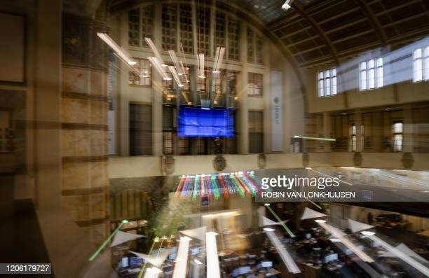 A picture taken on March 9 2020 shows the Euronext Amsterdam stock exchange as the fear of an economic recession due to the negative impact of the...