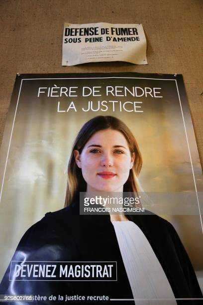 Picture taken on March 9 at the Tribunal de grande instance of Reims shows a poster reading 'Proud to deliver justice Become a magistrate' / AFP...