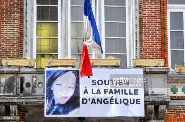 A picture taken on May 1 2018 in Wambrechies northern France shows a banner reading 'support to the family of Angelique' and bearing a picture of...