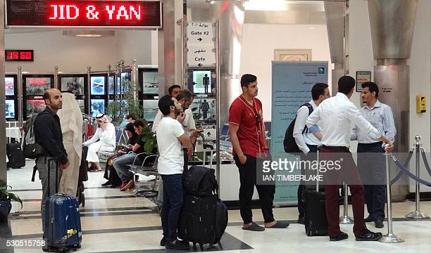 A picture taken on May 10 2016 shows Saudi Aramco staff awaiting their flights at the company's private terminal near Dhahran east of the capital...
