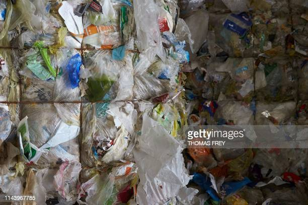 Picture taken on May 10, 2019 in Baerenbach shows compacted plastic waste at a plant of Hahn Kunststoffe, a leading firm in the recycling of plastic...