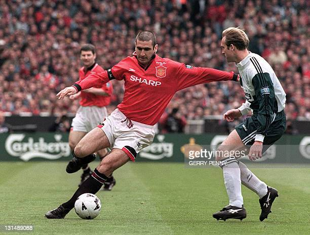 A picture taken on May 11 1996 shows Manchester United's Eric Cantona controlling the ball by Liverpool's John Scales during the final of the FA Cup...