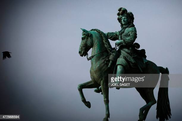 Picture taken on May 11, 2015 in Versailles Palace, southern Paris, shows a statue of the French King Louis XIV, as France marks in 2015 the 300th...