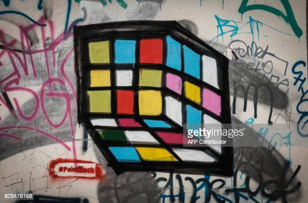 Picture taken on May 11 2016 shows a grafitti created from a swastika symbol by artist Ibo Omari resembling a Rubik's Cube in Berlin A ragtag band of...