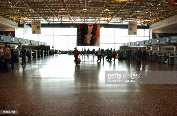 Picture taken on May 12 2004 in Varese of Alitalia checking counters at Malpensa International Airport north of Milan Air One is preparing to lodge a...