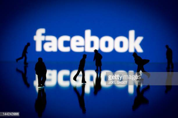 Picture taken on May 12 2012 in Paris shows an illustration made with figurines set up in front of Facebook's homepage Facebook already assured of...