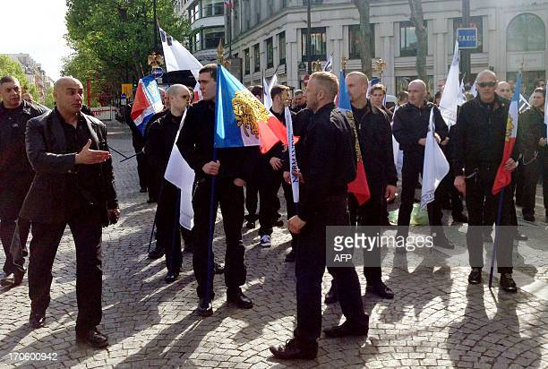 A picture taken on May 12 2013 shows farright militant Esteban Morillo holding a flag and Serge Ayoub aka Batskin leader of the Troisieme voie and...