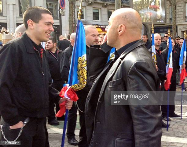 A picture taken on May 12 2013 shows farright militant Esteban Morillo standing in front of Serge Ayoub aka Batskin leader of the Troisieme voie and...