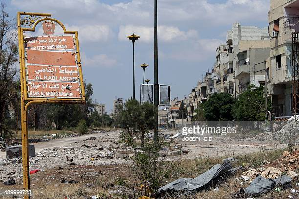 A picture taken on May 12 2014 shows a damaged street sign in a destroyed neighbourhood of the Old City of Homs some 162 kilometres north of the...