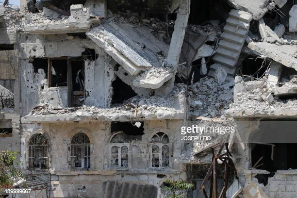 A picture taken on May 12 2014 shows a heavily damaged building in a destroyed neighbourhood of the Old City of Homs some 162 kilometres north of the...