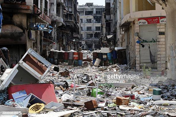 A picture taken on May 12 2014 shows a street strewn with detritus and remaining barrels in a destroyed neighbourhood of the Old City of Homs some...
