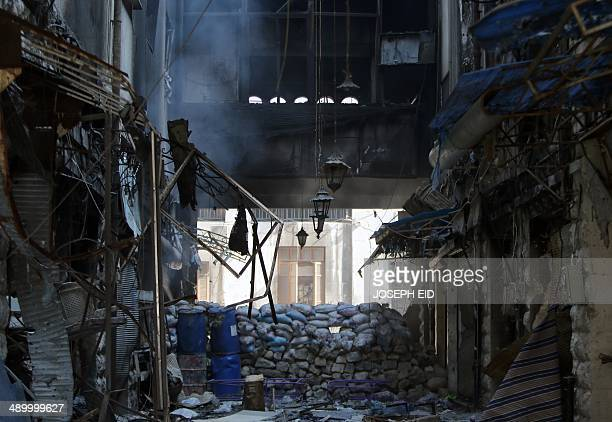 A picture taken on May 12 2014 shows remaining sandbags on a former frontline in a destroyed neighbourhood of the Old City of Homs some 162...