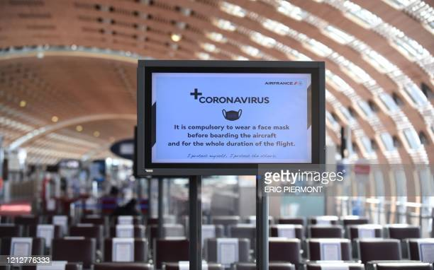 Picture taken on May 12, 2020 shows a screen bearing information regarding measures to curb the spread of the COVID-19, novel coronavirus, at the...