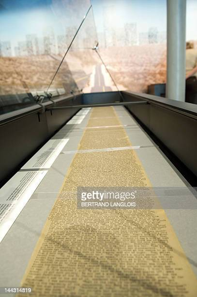 A picture taken on May 13 2012 shows the 120foot long original scroll of Jack Kerouac's On the Road as part of a wider exhibition on Kerouac's novel...