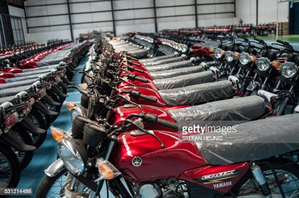 Picture taken on May 13, 2016 shows motorcycles assembled at the new Yamaha factory in Lagos, Nigeria on May 13, 2016. - CFAO Yamaha Nigeria Limited...