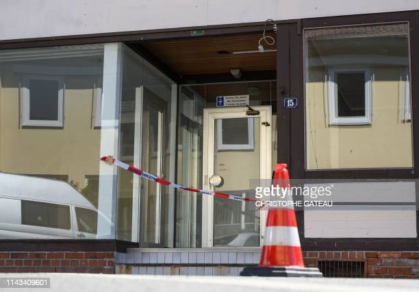 Picture taken on May 13 2019 shows a cordoned off house in Wittingen northern Germany where two bodies were found during investigations into the...