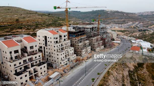 Picture taken on May 13, 2020 shows construction works in the Jewish settlement of Givat Zeev, near the Israeli-occupied West Bank city of Ramallah....