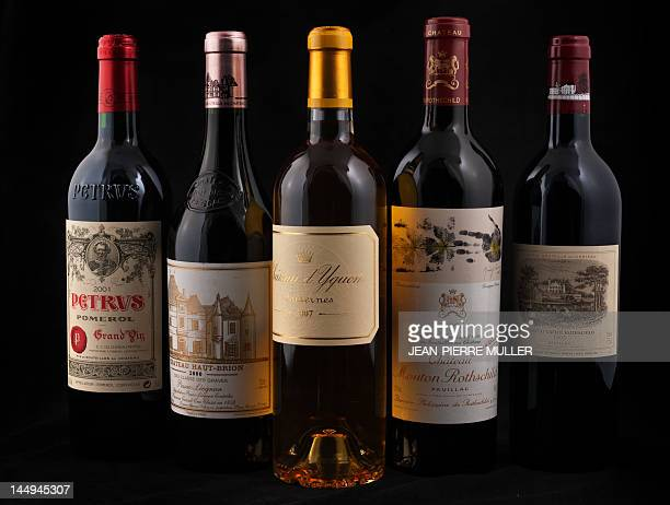 A picture taken on May 14 2012 in Bordeaux southwestern France shows bottles of French Bordeaux 'Grands Crus classes' wine Petrus Chateau Haut Brion...