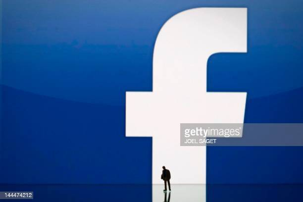 Picture taken on May 14, 2012 in Paris, shows an illustration made with a figurine set up in front of Facebook's homepage. Facebook, already assured...