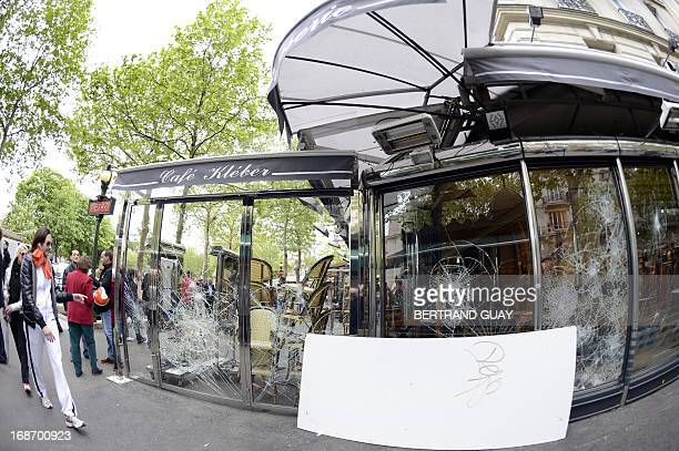 A picture taken on May 14 2013 shows broken shopwindows in Paris following clashes the night before when up to 15000 Paris SaintGermain fans had...