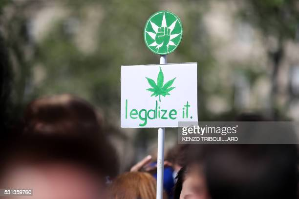 A picture taken on May 14 2016 shows a banner picturing a cannabis leaf and reading 'legalize it' during the 15th World March for cannabis to call...