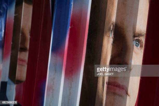 TOPSHOT A picture taken on May 14 2017 shows an electoral poster of French presidential election candidate for the En Marche movement Emmanuel Macron...