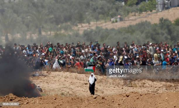TOPSHOT A picture taken on May 14 2018 from the southern Israeli kibbutz of Nahal Oz across the border with the Gaza Strip shows Palestinian...