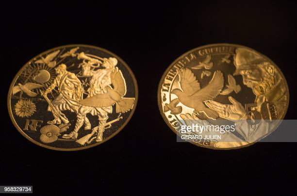 A picture taken on May 14 2018 in Paris shows the first Fairmined coin emitted by the Monnaie de Paris The label Fairmined gives evidence of the...