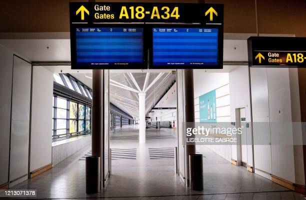 A picture taken on May 15 2020 shows empty screens at almost empty Copenhagen Airport amid the new coronavirus pandemic / Denmark OUT