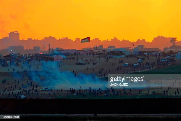 TOPSHOT A picture taken on May 15 from the southern Israeli kibbutz of Nahal Oz across the border with the Gaza strip shows tear gas fumes rising...