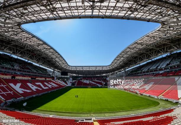 A picture taken on May 16 2018 shows the stands and the pitch of the Kazan Arena in the Russian city of Kazan The stadium will host four group games...