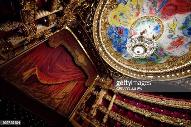 A picture taken on May 17 2018 shows the Chagall's frescoes painted on the ceiling and the stage of the Opera Garnier in Paris