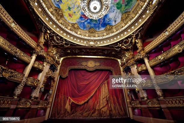 A picture taken on May 17 2018 shows the stage and the Chagall's frescoes painted on the ceiling of the Opera Garnier in Paris