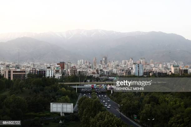 A picture taken on May 18 2017 shows the skyline of northern Tehran from the 'Nature' bridge in the capital Tehran on the eve of the presidential...