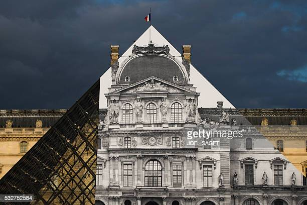 A picture taken on May 19 2016 in Paris shows the Louvre Pyramid covered with a giant photograph of the museum by French artist and photographer JR...