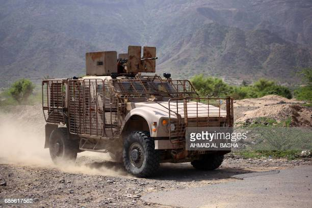 Picture taken on May 19, 2017 in Yemen's third-city of Taez shows an armoured vehicle belonging to Yemeni fighters supporting forces loyal to Yemen's...