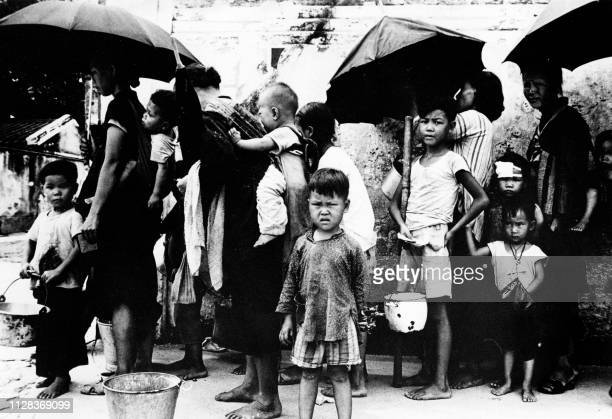 Picture taken on May 1962 showing Chinese refugees queuing for a meal at Hong Kong During the famine caused by The Great Leap Forward Chinese policy...