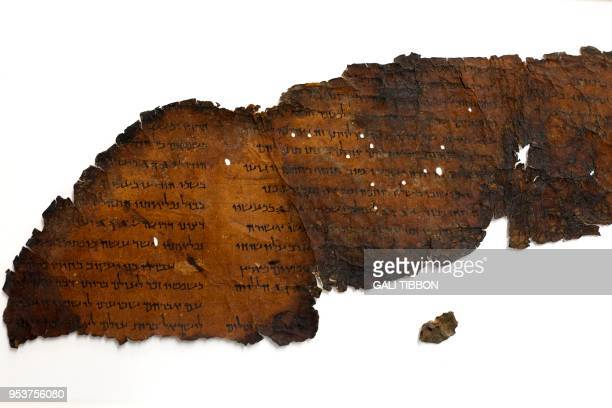 A picture taken on May 2 2018 at the Israel Antiquities Authority's Dead Sea scrolls conservation laboratory in Jerusalem shows a large fragment of a...