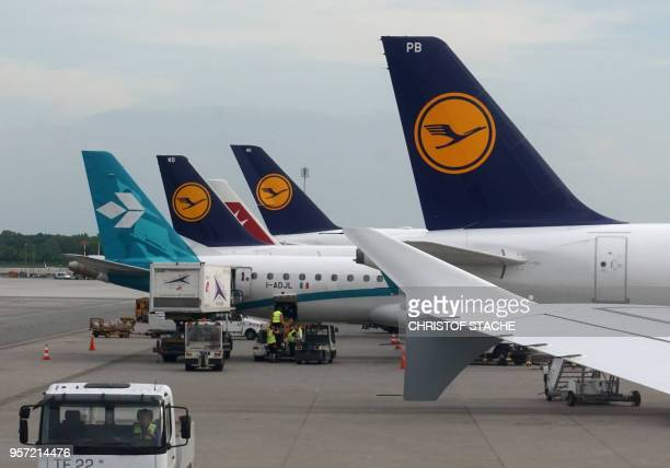 A picture taken on May 2 2018 shows aircrafts of the German airline Lufthansa parked at the FranzJosefStrauss airport in Munich southern Germany