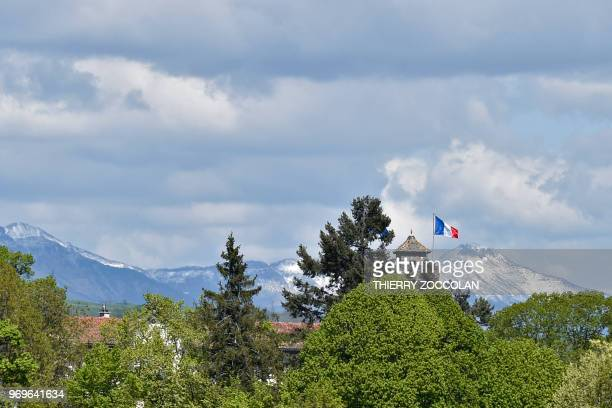 A picture taken on May 2 2018 shows the Chateau de Saint Etienne and the Cantal mountain outside Aurillac The initiative 'A roof a job' helps former...